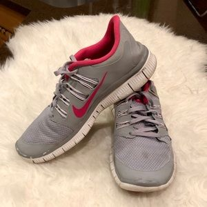 Nike grey with pink swoosh, size 9.5.